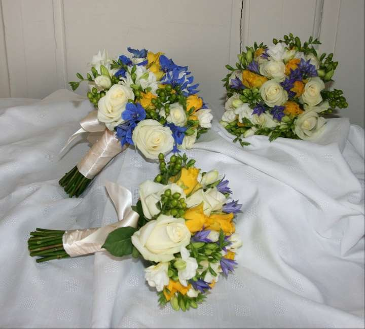 Blue, yellow and ivory bride and bridesmaid bouquets