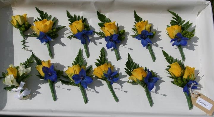 Yellow rose and blue delphinium buttonhole