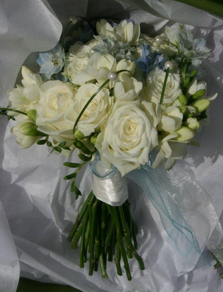 Ivory and baby blue bridal bouquet overlaid with peals