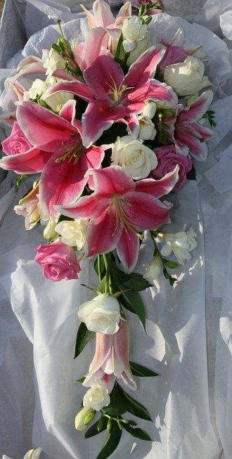 Stunning shower bouquet of pink lily and white roses