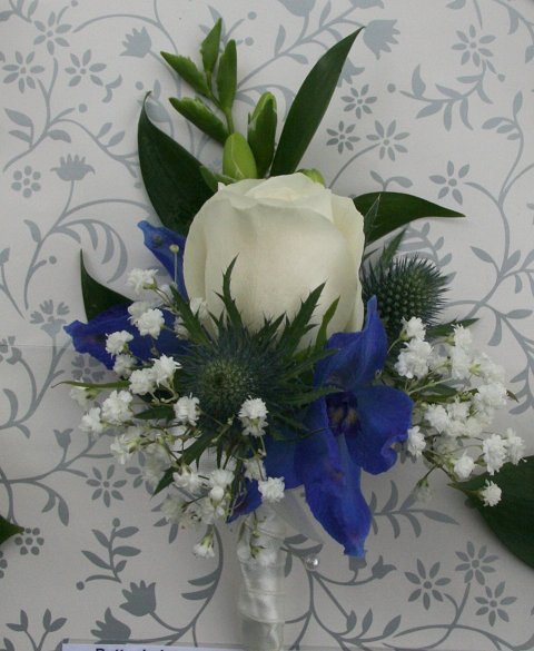 Rose,delphinium and thistle buttonhole