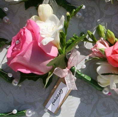 Pink rose and freesia buttonhole