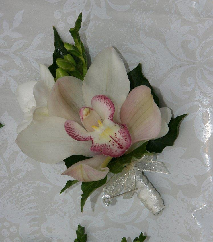 Orchid buttonhole with freesia