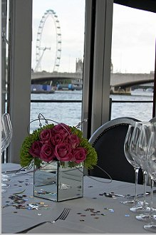 The Yacht, London, Mirror cube filled with roses and chrysanthumums  with entwigned pearl beads
