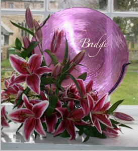 Corporate flower arrangement incorporating name of The Bridge Hotel using stargazer lilies