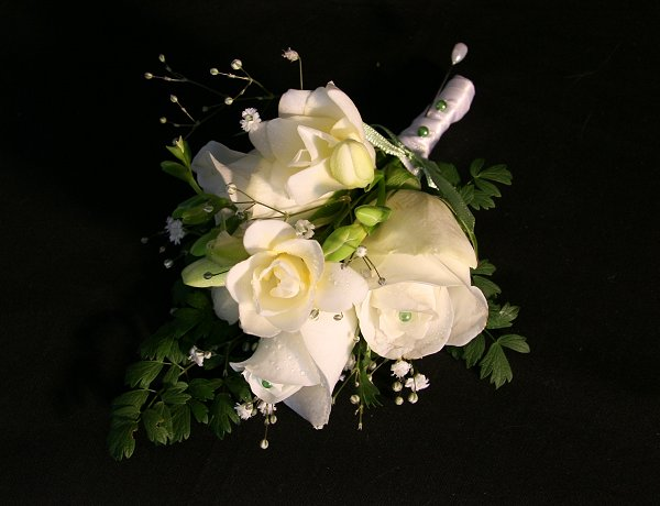 white fresh flower corsage of roses and freesia