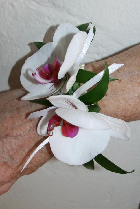 Wrist corsage of white orchids