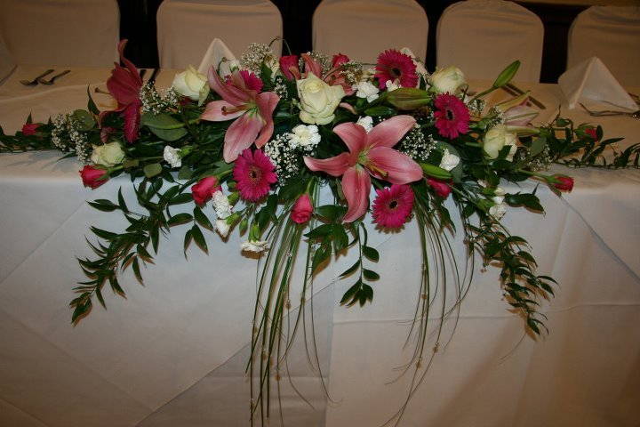 Top table wedding flowers in pink and ivory
