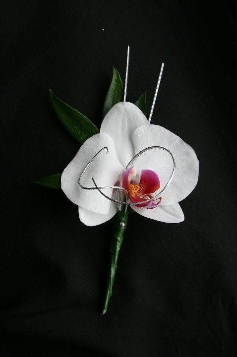 Orchid grooms buttonhole with silver loops