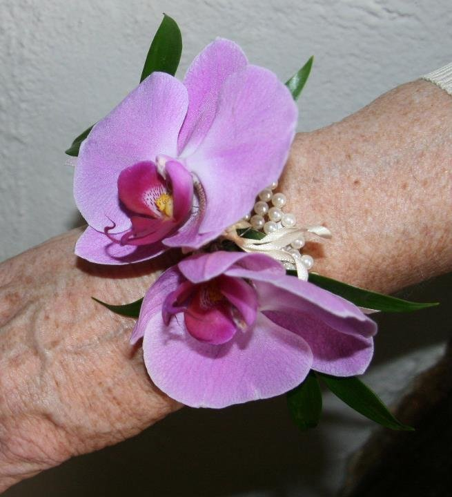 Wrist corsage of pink orchids