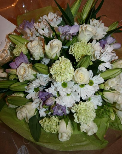 Delicate mix of green and white mixed flower presentation posy gift