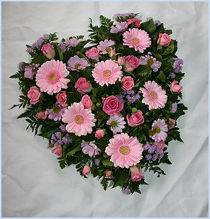 Loose Heart shape sympathy wreath with pink roses, lilac freesia and pale pink gerbera