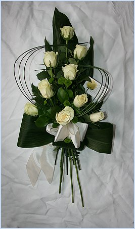 Contemporary Rose sympathy spray with white roses entwined with bear grass