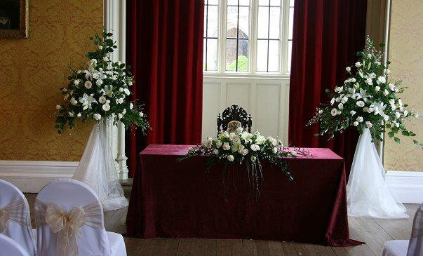 Wedding  flowers, pedestals of ivory flowers