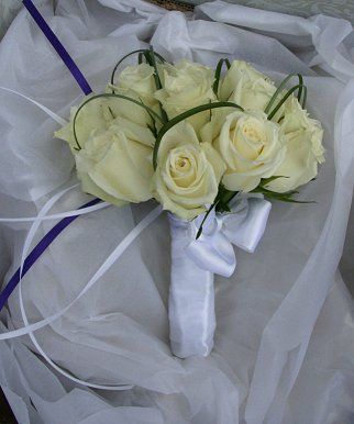 Bridesmaid bouquet of white roses with green overlay