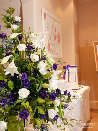 Purle and white wedding pedestal of flowers, Felix hotel, Cambridge
