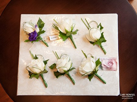 Ivory rose  and purple buttonholes