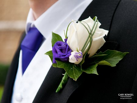Ivory rose and purple lizianthus groom buttonhole