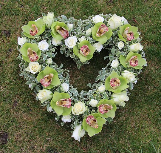 Open heart sympathy wreath with orchids and roses