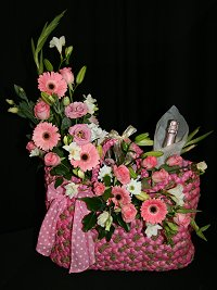 "Pink Basket of flowers with ""bubbly"""
