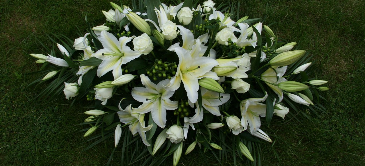 white and green coffin tribute