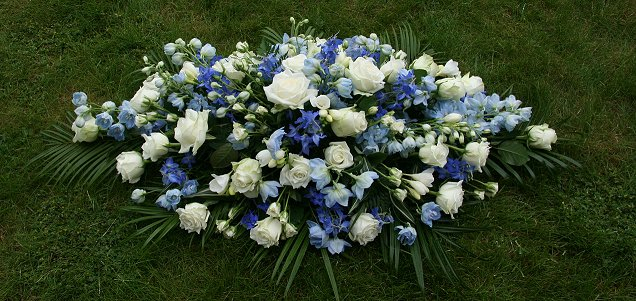 Blue and white coffin tribute wreath