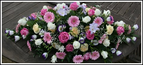 Sympathy Coffin Spray comprising delicate pink gerbera, rose, freesia, lisianthus, carnation and gyp