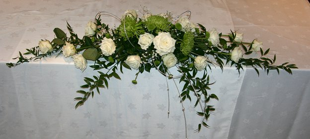 Contemporary Green and white top table flower arrangement, The Felix Hotel, Cambridge