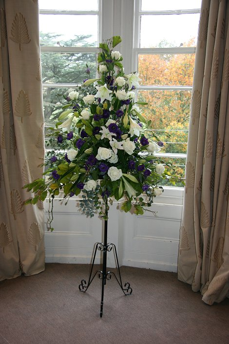 Purple and white wedding pedestal of flowers, The Felix Hotel, Cambridge