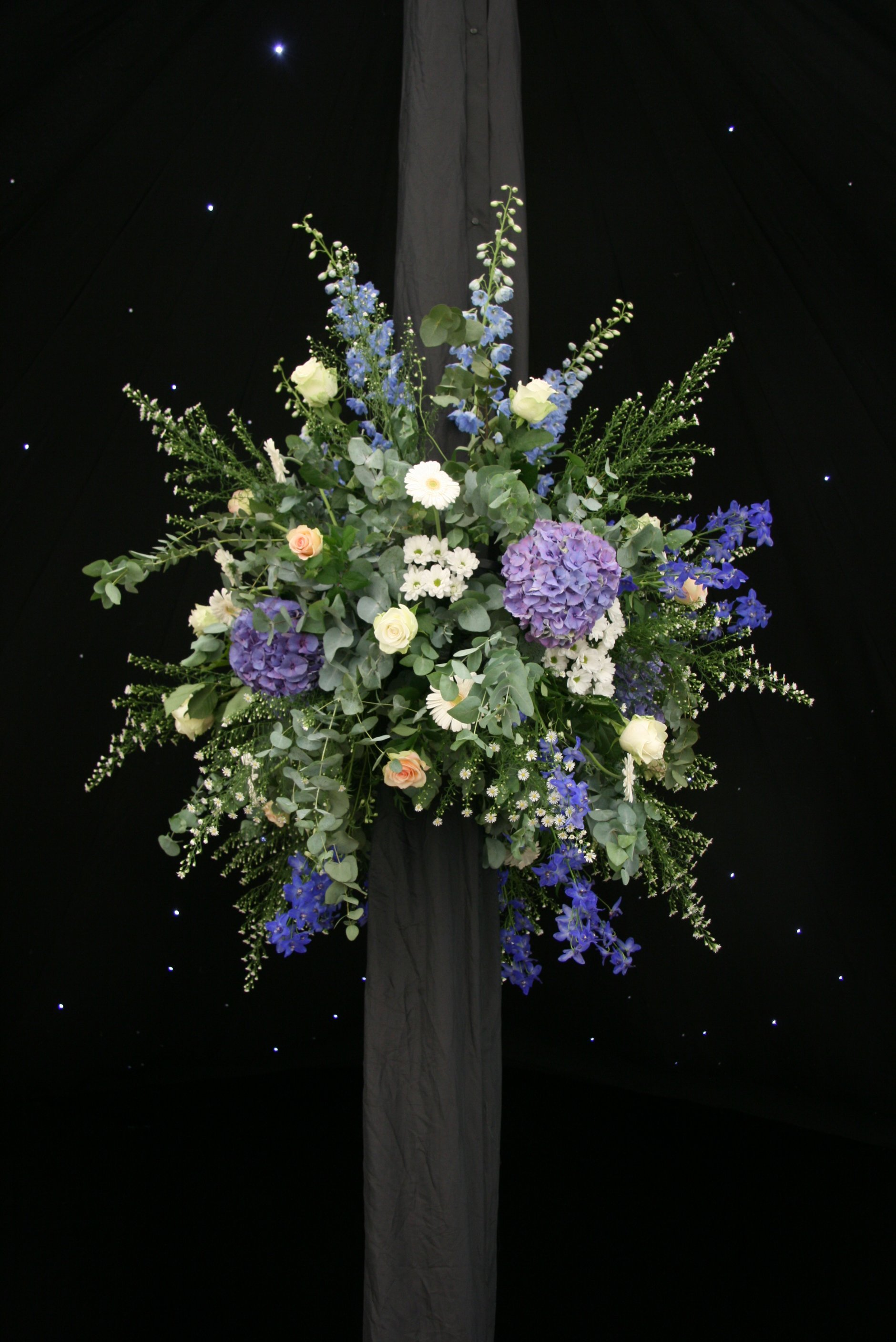 Marquee pole flowers