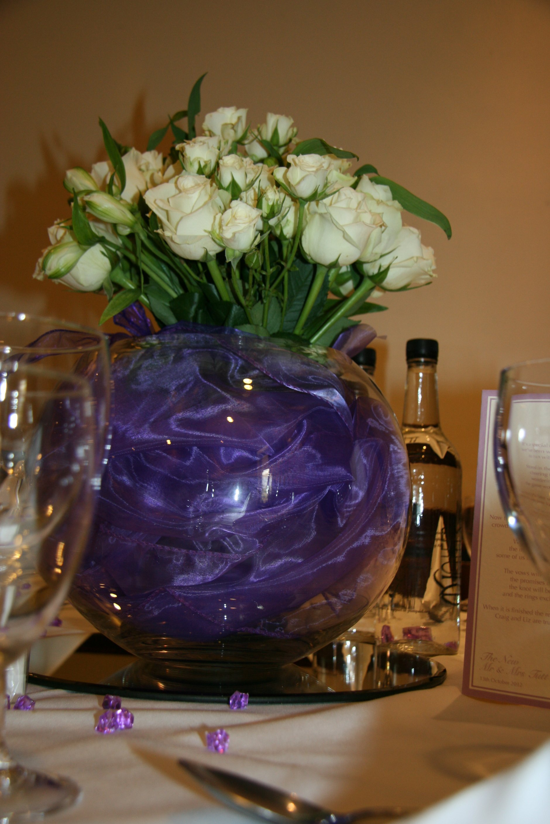 Purple filled rose bowls with roses, Belfry Hotel, Cambourne