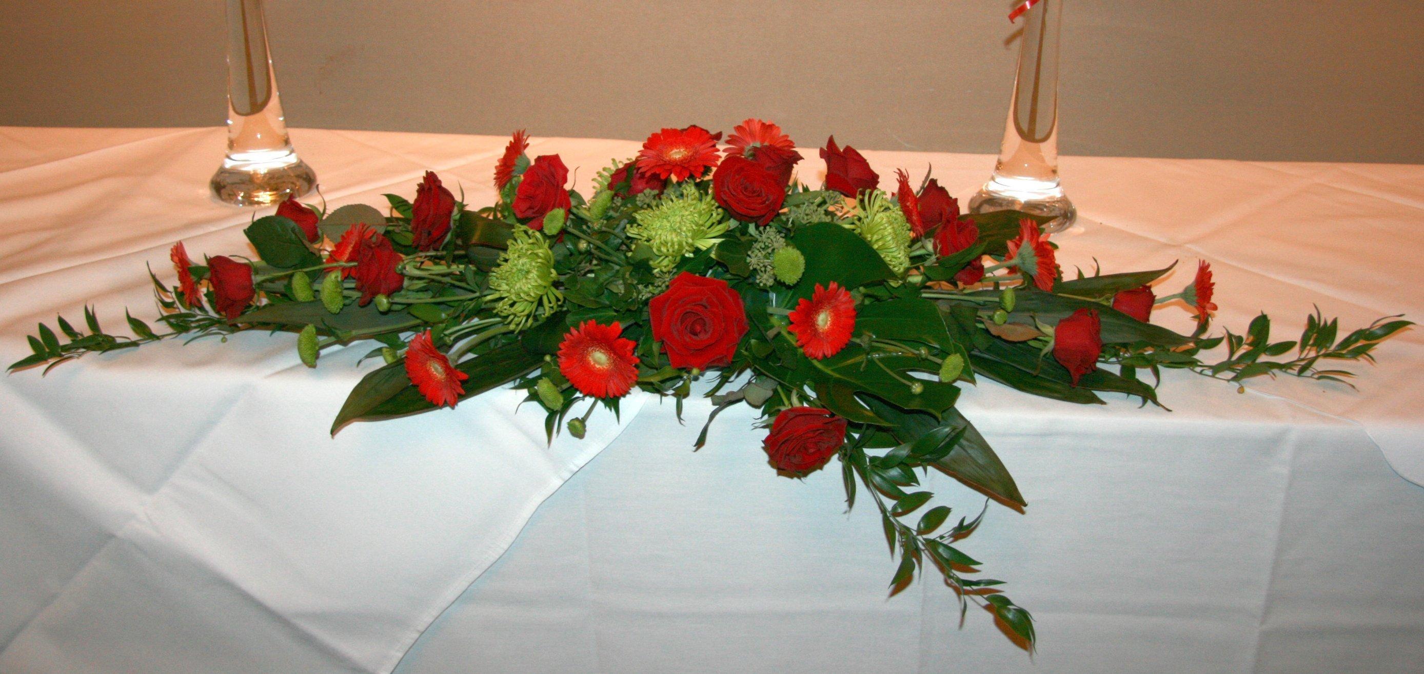 Red wedding flower top table arrangement