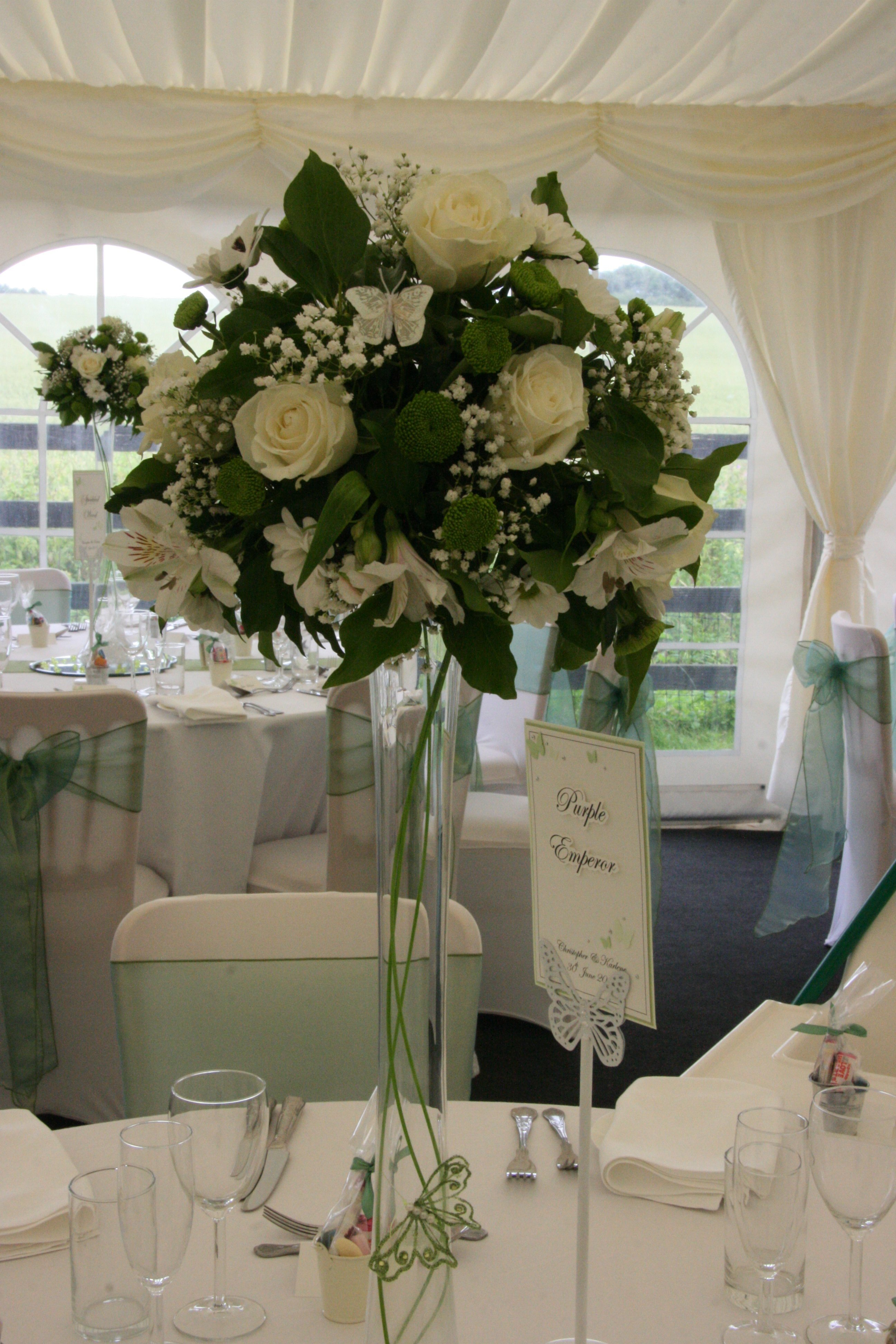 Green and white themed wedding table centrepiece flowers