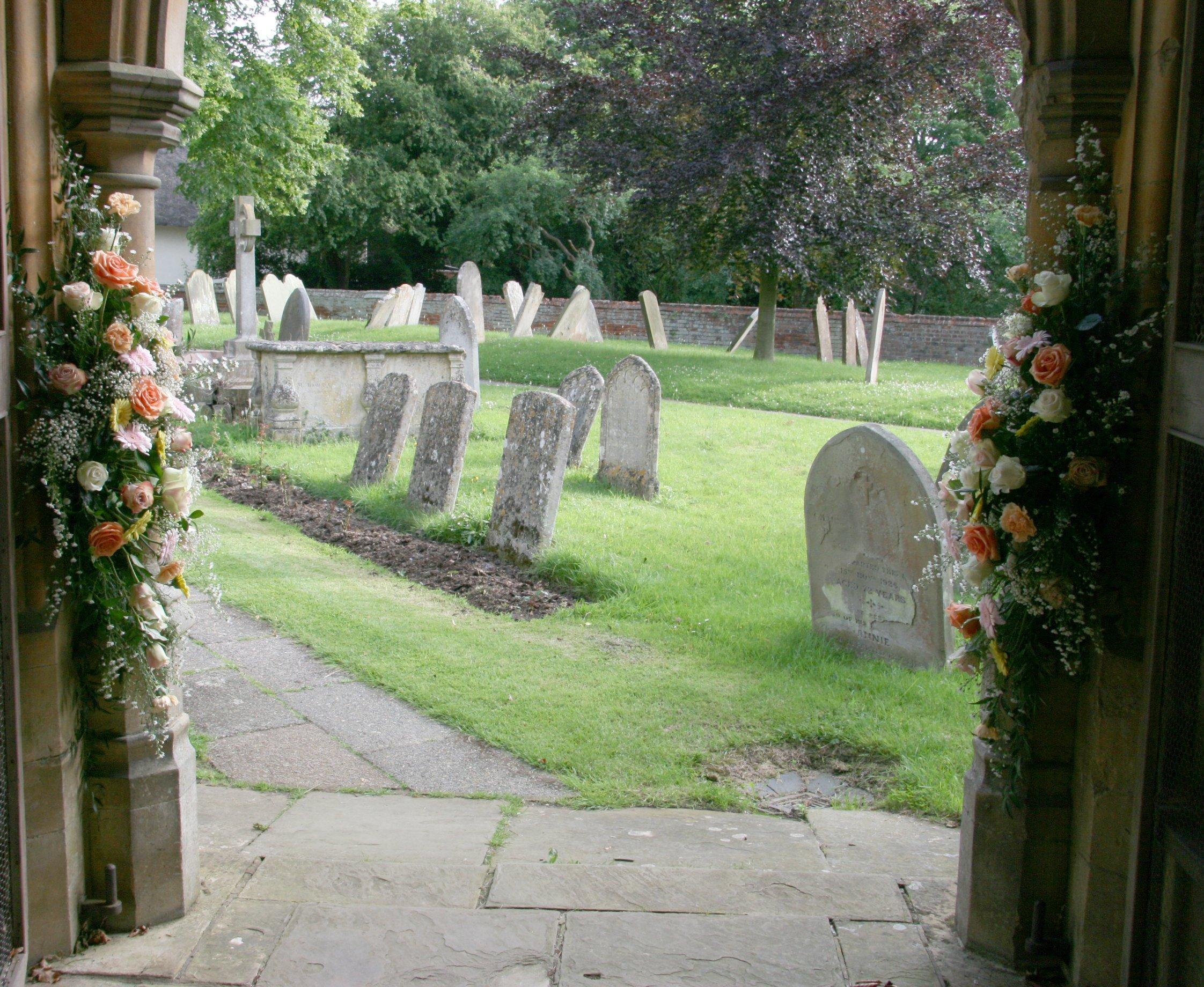 Church entrance wedding flowers