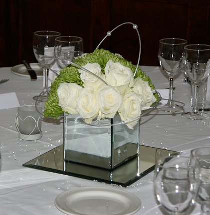 Mirror cube of fresh green and ivory flowers as wedding table centrepiece at The Felix Hotel, Cambridge