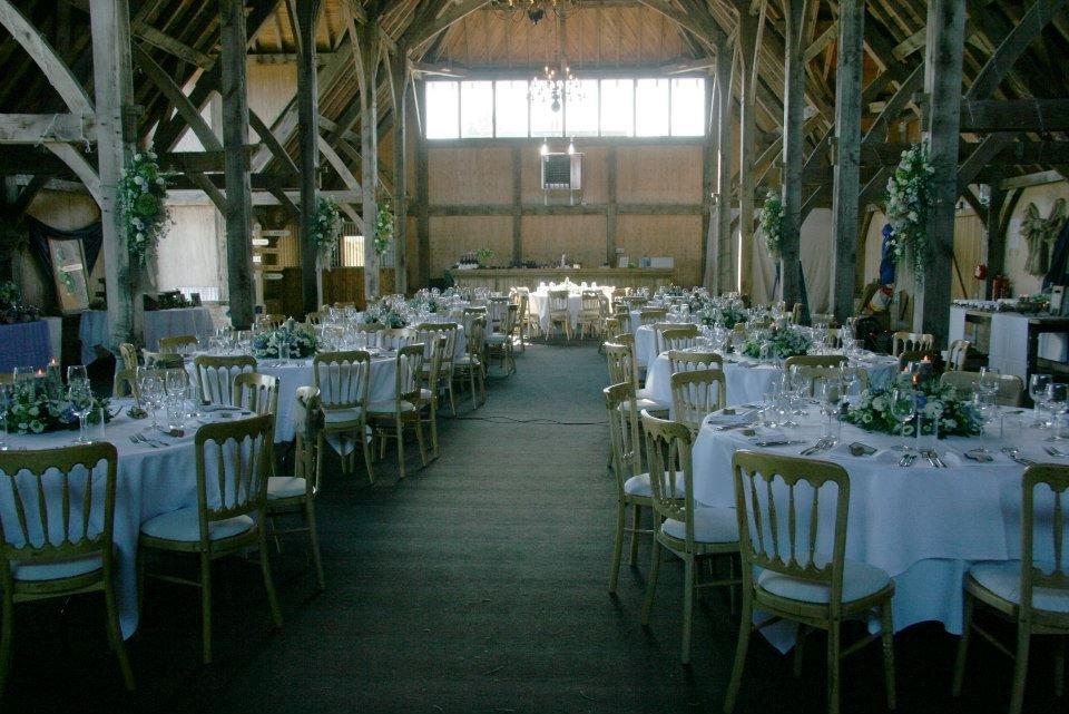 Wedding reception in barn flower arrangements