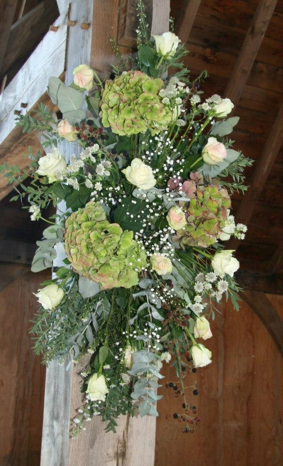 Barn beams decorated with country flowers and hessian