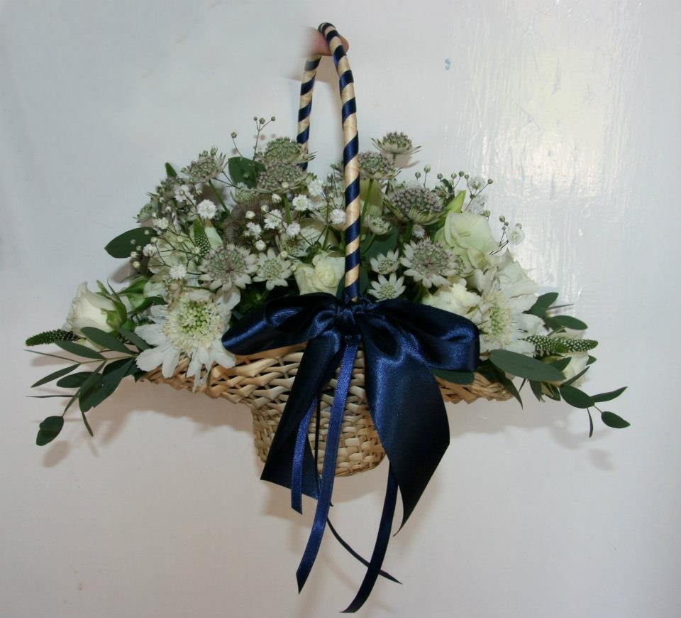 Country style flowergirl basket of flowers